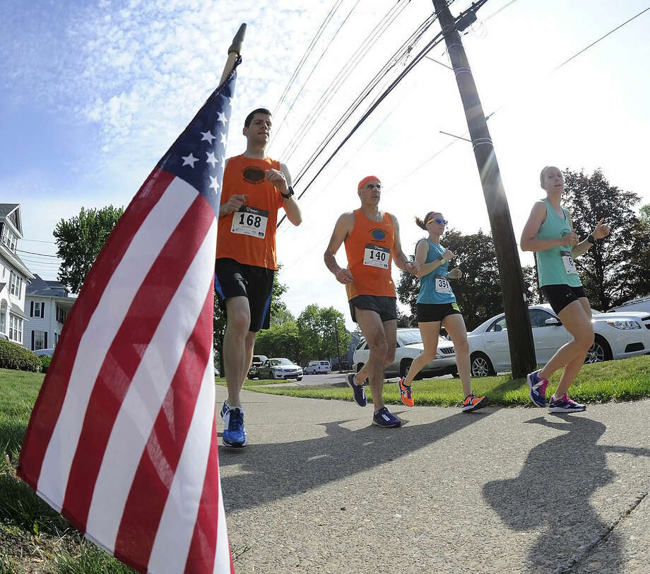 A group of runners warms up before the start of the Memorial Day Five Mile run, Monday, May 25, 2015, in Forty Fort, Pa. (Mark Moran/The Citizens' Voice via AP)
