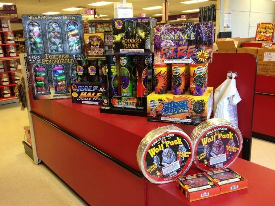 This Thursday, May 8, 2014 photo shows the types of fireworks purchased Sunday, May 4, 2014 by Darrin Campbell, according to the Phantom Fireworks store in Tampa, Fla. Campbell and his family were found dead inside a burned-down million-dollar home owned by former tennis professional James Blake in Florida, days after the fireworks were purchased. Authorities have called the fire arson, but have not said what role, if any, the fireworks played in the blaze. (AP Photo/Tamara Lush)