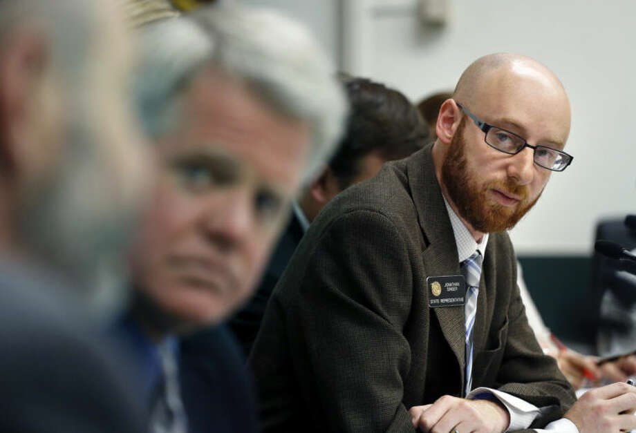Rep. Jonathan Singer, D-Longmont, listens to discussion on a bill he sponsored which would allow marijuana dispensaries to form financial co-operatives, at the Colorado Legislature, in Denver, Wednesday May 7, 2014. The plan to create the world's first financial system for marijuana came back to life in the Colorado Legislature May 7 when lawmakers revived the bill which sponsors called the state's best hope for moving the marijuana industry away from its all-cash basis. (AP Photo/Brennan Linsley)