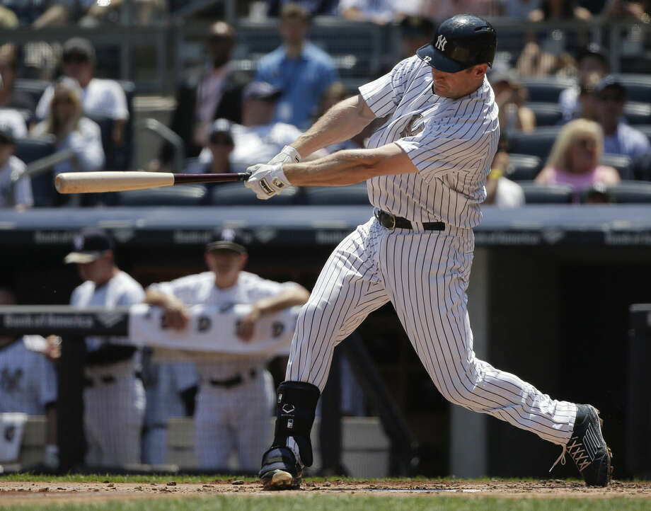 New York Yankees third baseman Chase Headley (12) connects for a two-run home run against the Kansas City Royals during the first inning of a baseball game, Monday, May 25, 2015, in New York. (AP Photo/Julie Jacobson)