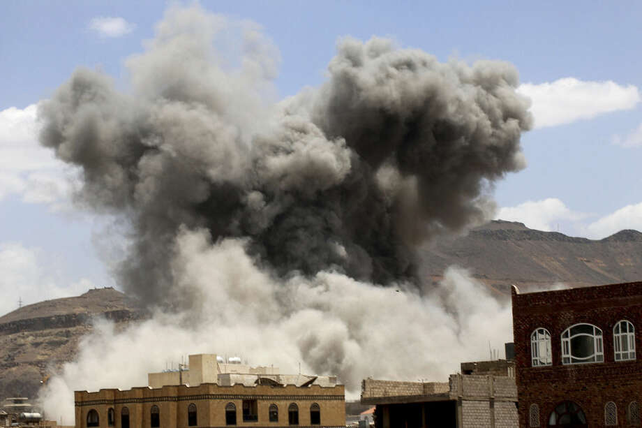 Smoke rises after a Saudi-led airstrike targeted a military base in Sanaa, Yemen, Sunday, May 24, 2015. Fighting raged on in Yemen on Sunday, with airstrikes by the Saudi-led coalition hitting rebel targets in multiple cities, including the capital, while street battles in the city of Taiz killed several civilians. (Photo/Shohdi Alsofi)