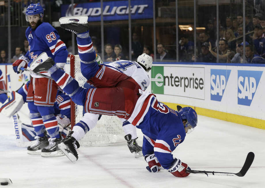 New York Rangers defenseman Dan Boyle (22) collides with Tampa Bay Lightning right wing Ryan Callahan (24) during the third period of Game 5 of the Eastern Conference final during the NHL hockey Stanley Cup playoffs, Sunday, May 24, 2015, in New York. The Lightning won 2-0. (AP Photo/Frank Franklin)