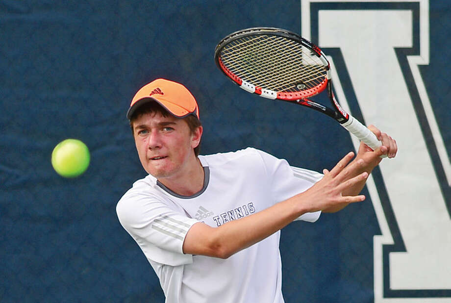 Hour photo / Erik Trautmann Staples High School's #2 single William Andrew plays Wilton's Ian Erickson during their FCIAC Boys Tennis final in Westport Thursday.