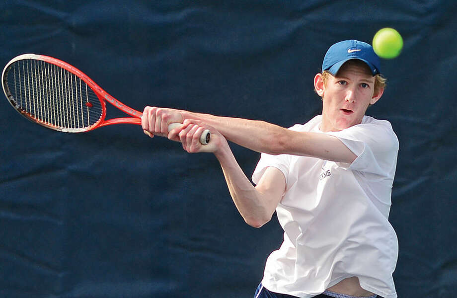 Hour photo / Erik Trautmann Wilton High School's #1 single Gerrit Gilliard plays Staples' Zack Levin during their FCIAC Boys Tennis final in Westport Thursday.