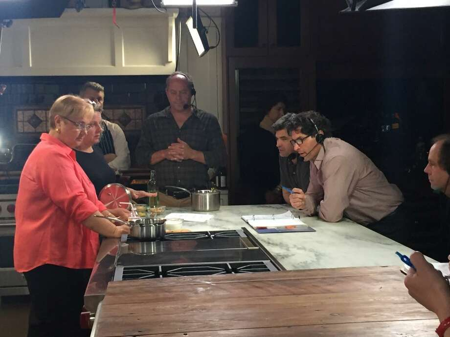 Lidia and the production team consider a fan question and discuss how to best address it. (Photo: Contributed)