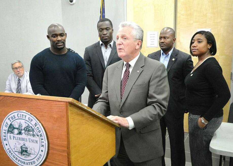 Hour Photo/Alex von Kleydorff Mayor Harry Rilling honors Silas Redd and Kevin Pierre-Louis with help from Councilman Travis Simms and Faye Bowen at City Hall