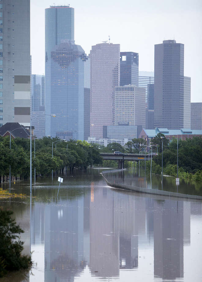 Memorial Drive in Houston is flooded after storms flooded the area, Tuesday, May 26, 2015. Overnight heavy rains caused flooding closing some portions of major highways in the Houston area. (Cody Duty/Houston Chronicle via AP)