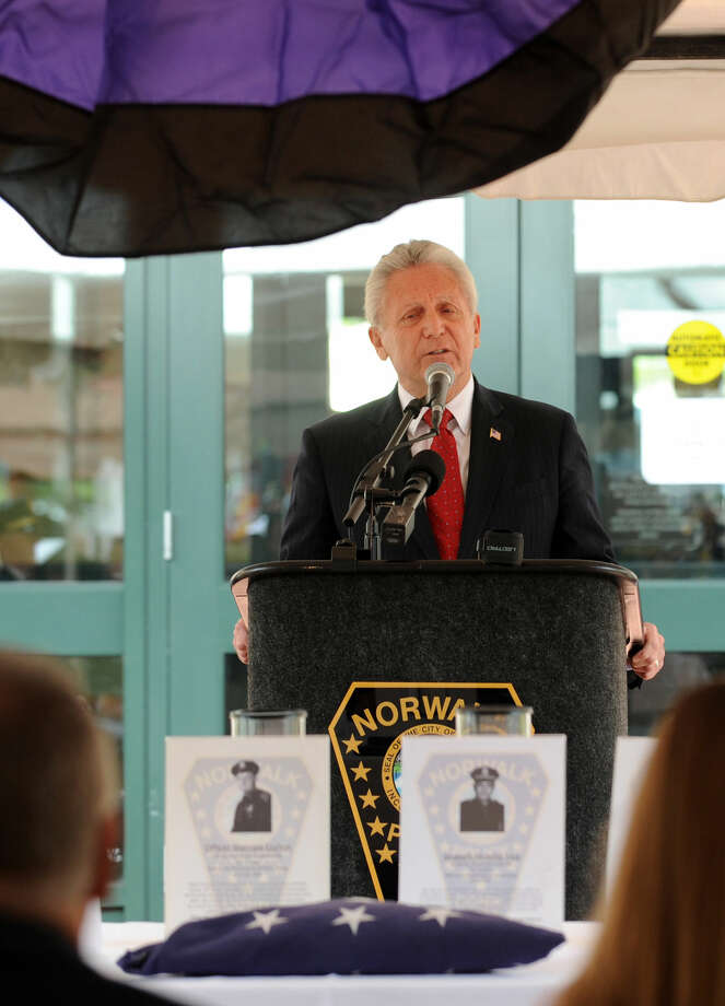 Norwalk Mayor Harry Rilling speaks at the annual Norwalk Police Department Memorial on Wednesday, May 18, 2016 at police headquarters in Norwalk, Conn. The service was held as part of national police week to honor the memory of fellow officers who have lost their lives in the service as well as those lost to suicide.