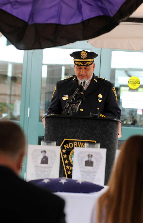Police Chief Thomas Kulhawik speaks at the annual Norwalk Police Department Memorial on Wednesday, May 18, 2016 at police headquarters in Norwalk, Conn. The service was held as part of national police week to honor the memory of fellow officers who have lost their lives in the service as well as those lost to suicide.