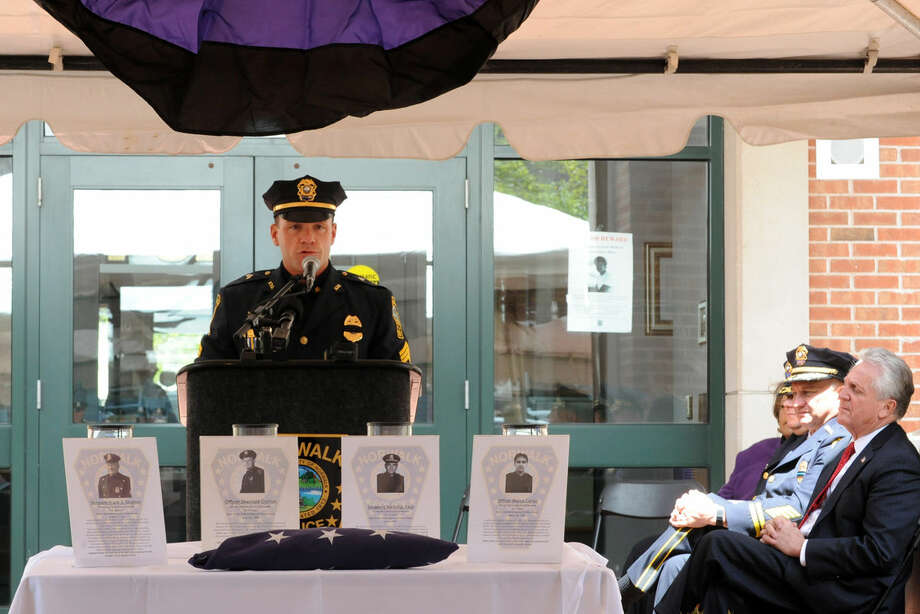 TSgt David Orr, union president, speaks at the annual Norwalk Police Department Memorial on Wednesday, May 18, 2016 at police headquarters in Norwalk, Conn. The service was held as part of national police week to honor the memory of fellow officers who have lost their lives in the service as well as those lost to suicide.