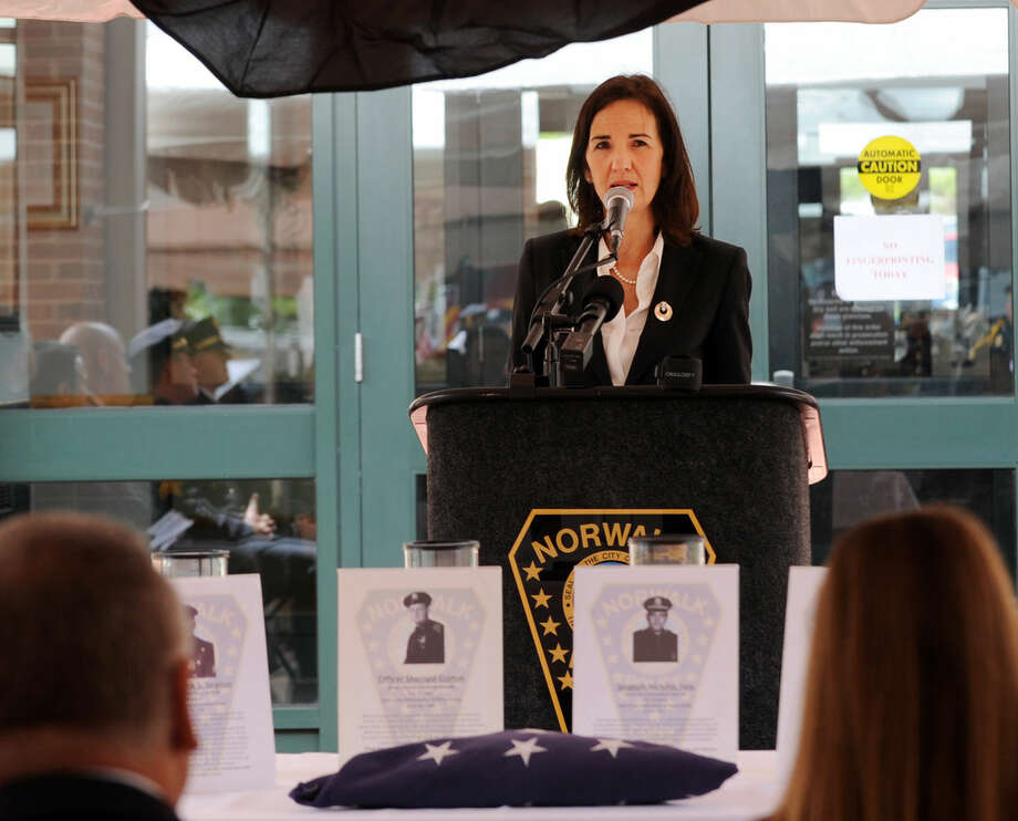 U.S. Attorney Deirdre Daly speaks at the annual Norwalk Police Department Memorial on Wednesday, May 18, 2016 at police headquarters in Norwalk, Conn. The service was held as part of national police week to honor the memory of fellow officers who have lost their lives in the service as well as those lost to suicide.