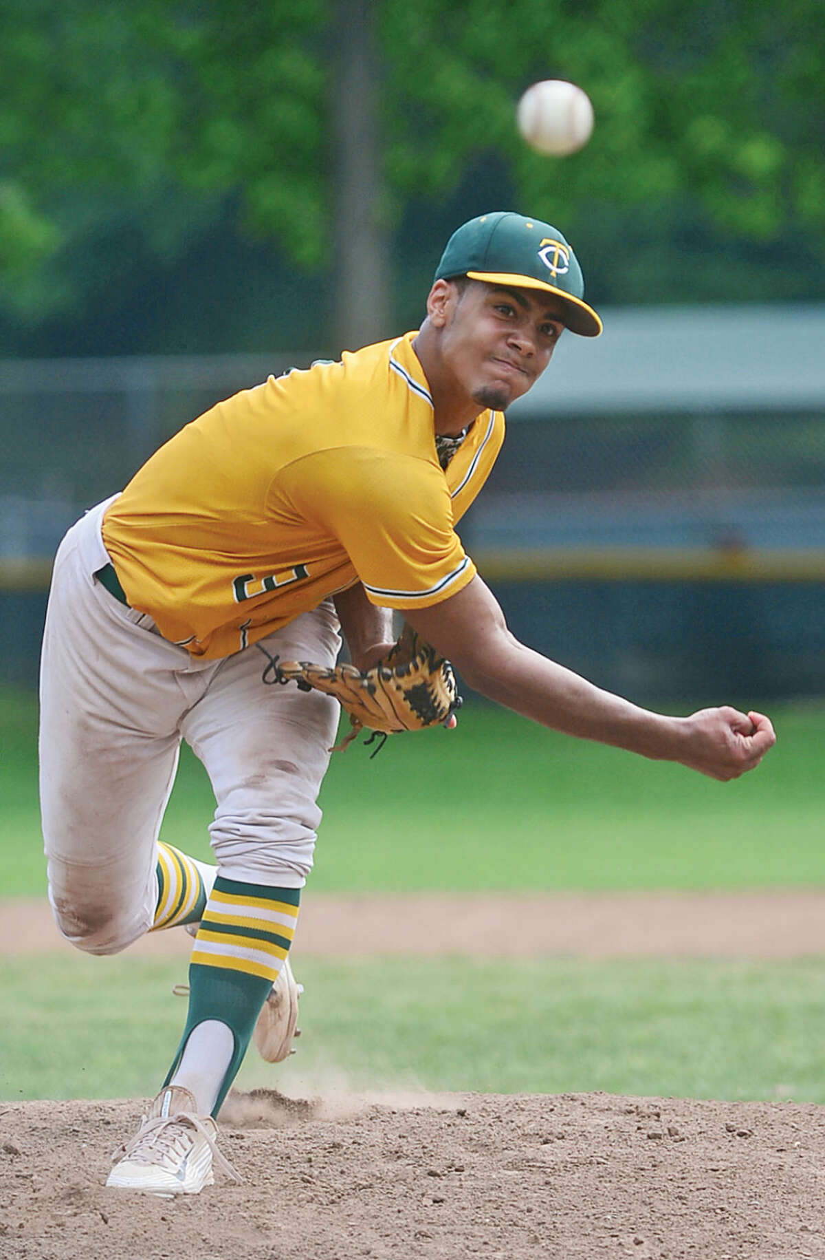 Hour photo / Erik Trautmann Trinity Catholic's pitcher Randy Polonia throws against New Canaan during their FCIAC semi final Tuesday at Mead Park in New Canaan.