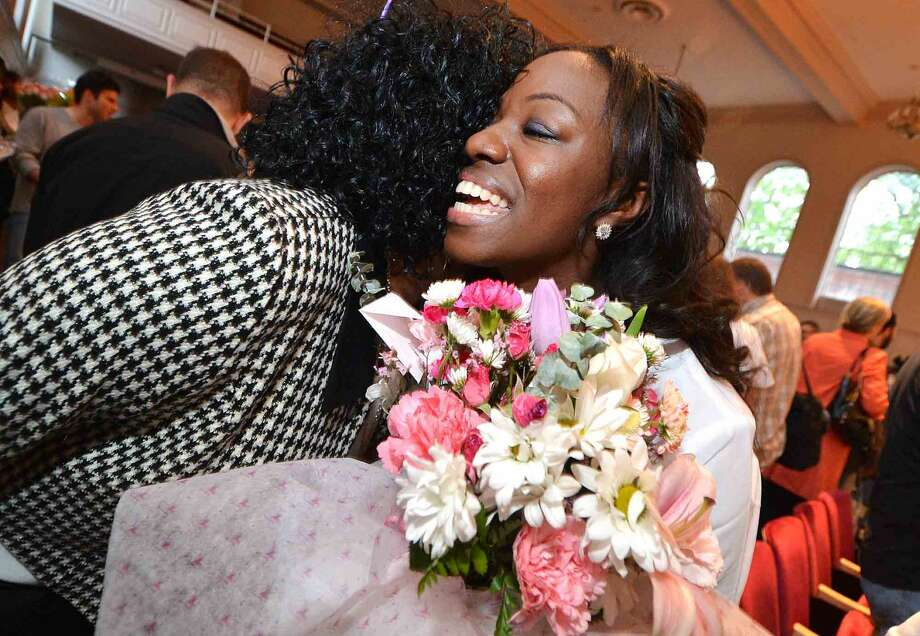 Norwalk's Janelle Fludd gets hugs and flowers after graduating at the the Norwalk Community College Nursing Class of 2016 Pinning Ceremony at City Hall in Norwalk Conn. Tuesday May 17, 2016