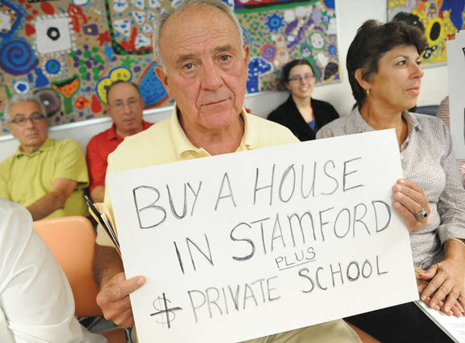 Stamford resident Carmine Limone among protesters seated before the Board of Education meeting Tuesday night at the Stamford Government Center. Photo/Matthew Vinci