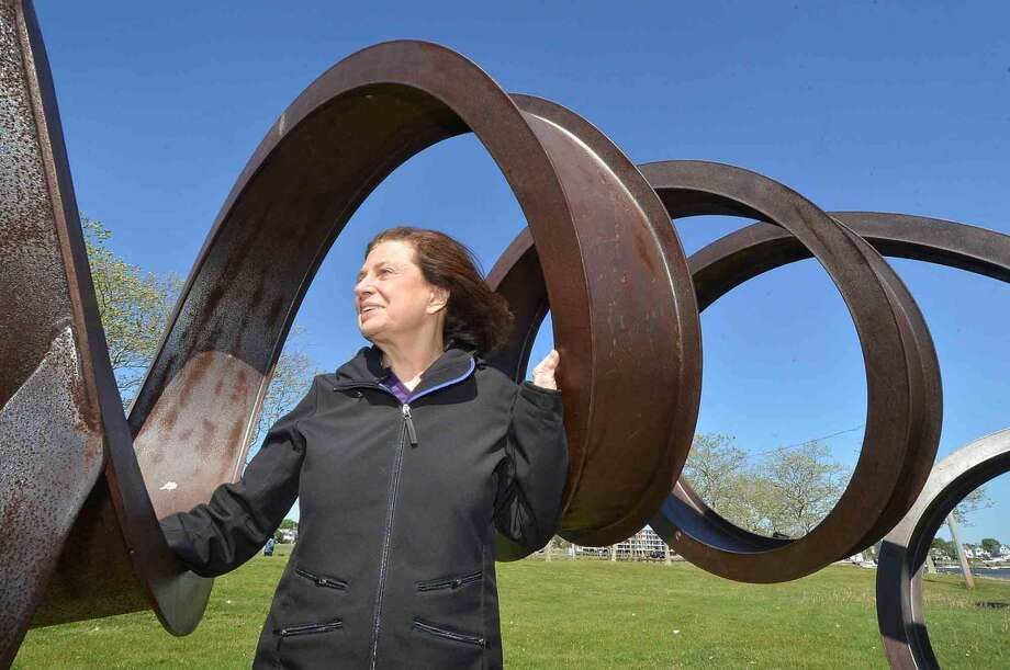 Weston artist Carole Eisner with her Rolled I Beam sculpture 'Spring-A-Ling' on view at Veterans Park in Norwalk. This and others of hers from Vets Park are being moved to Prospect Park in Brooklyn, N.Y.. In Norwalk Conn. Monday May 16, 2016