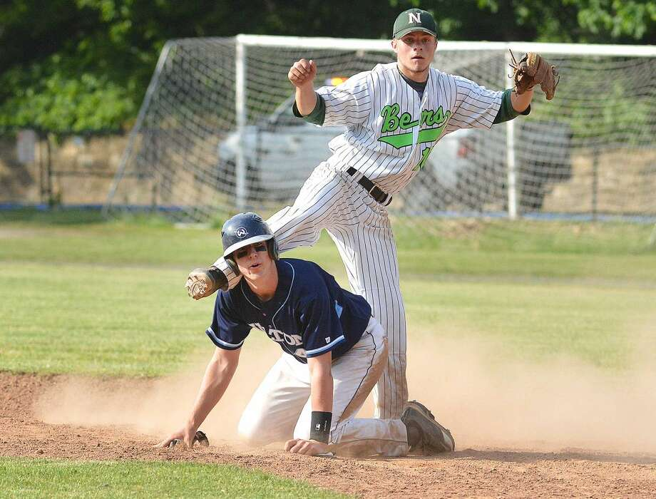Hour Photo/Alex von Kleydorff Norwalks #10 Dave Balunek tags the base and makes the throw vs Wilton's #41 Harry Sabo