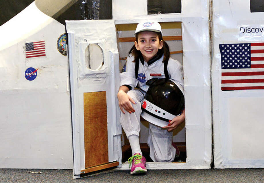 Hour photo / Erik Trautmann Commander Sofia Tsiropoulos is the first to exit the shuttle as Columbus Magnet School observes the 19th annual Young Astronaut mission, Terra Nova simulated landing at Friday morning.