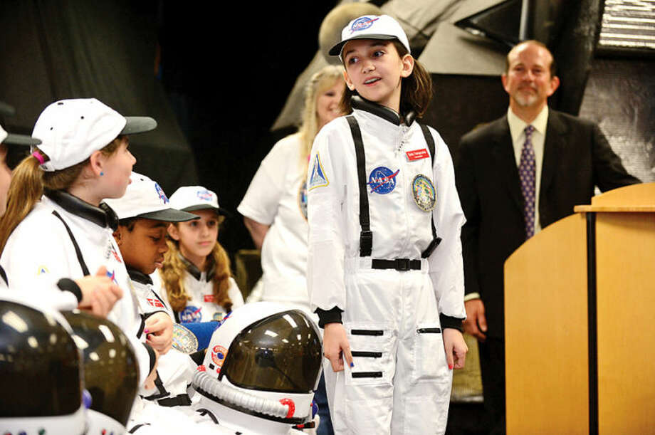 Hour photo / Erik Trautmann Commander Sofia Tsiropoulos answers questions from teachers and dignitaries as Columbus Magnet School observes the 19th annual Young Astronaut mission, Terra Nova simulated landing at Friday morning.