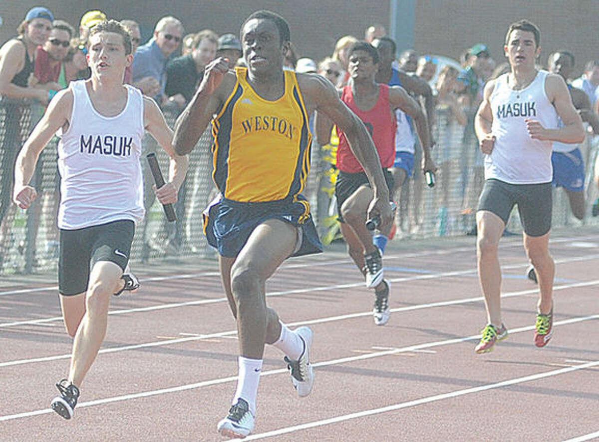 Simeon Okoro Weston wins boys 4 x 100. Hour photo/Matthew Vinci