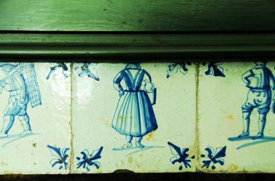 An image of the Weir House, Delft Tile Framed Fireplace.