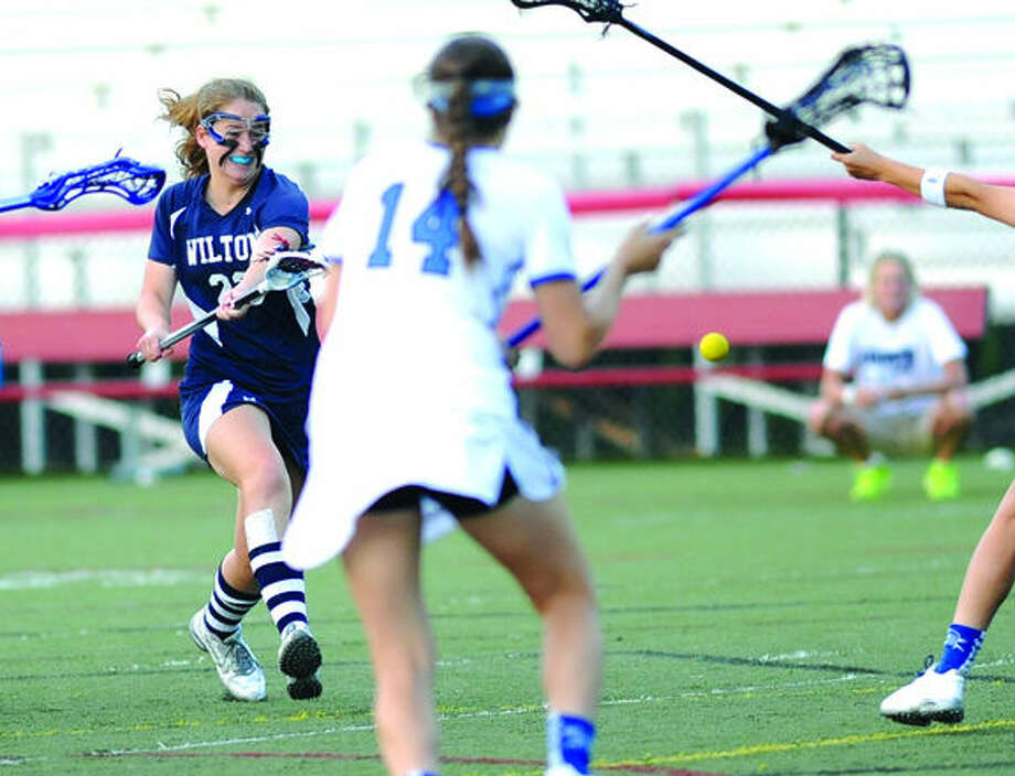 Wilton girls lacross, #23 Sara Dickinson, Darien, Julia Arrix. Hour photo/Matthew Vinci