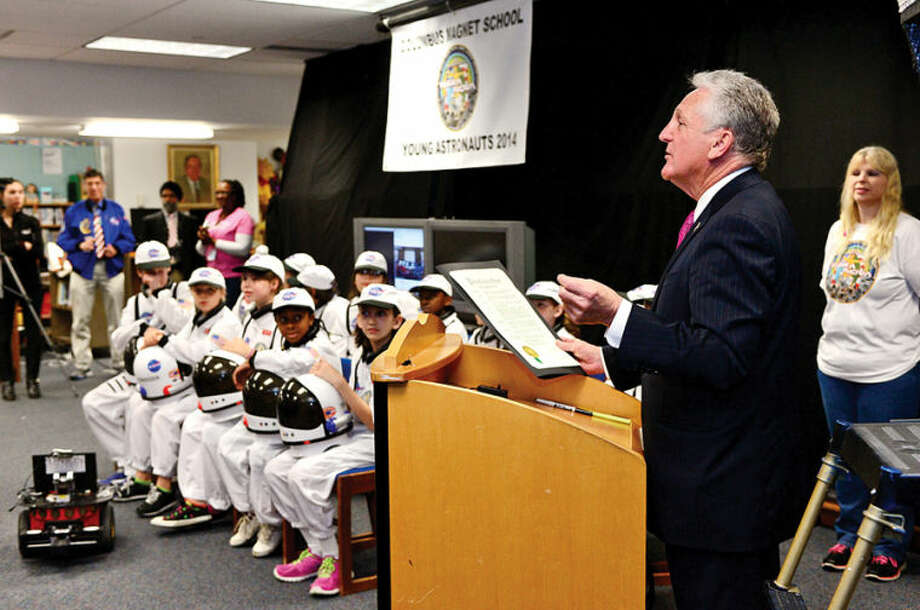 Hour photo / Erik Trautmann Norwalk mayor Harry Rilling reads a proclamation as Columbus Magnet School observes the 19th annual Young Astronaut mission, Terra Nova simulated landing at Friday morning.