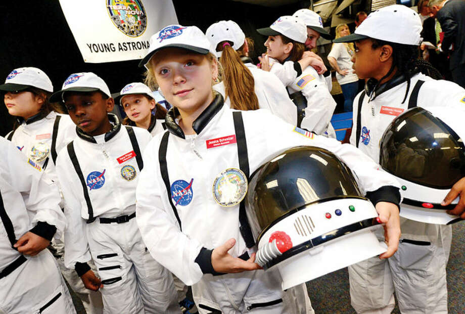 Hour photo / Erik Trautmann Mission specialist Jessica Schweizer stands proud with her fellow astronauts as Columbus Magnet School observes the 19th annual Young Astronaut mission, Terra Nova simulated landing at Friday morning.