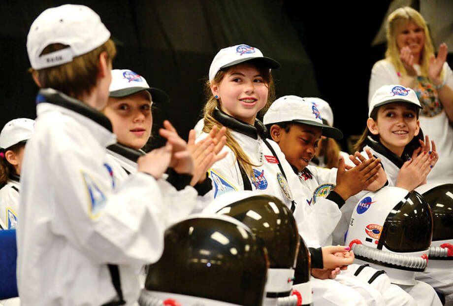 Hour photo / Erik Trautmann Mission Specialist Rachel Oberst and the other young astronauts celebrate as Columbus Magnet School observes the 19th annual Young Astronaut mission, Terra Nova simulated landing at Friday morning.
