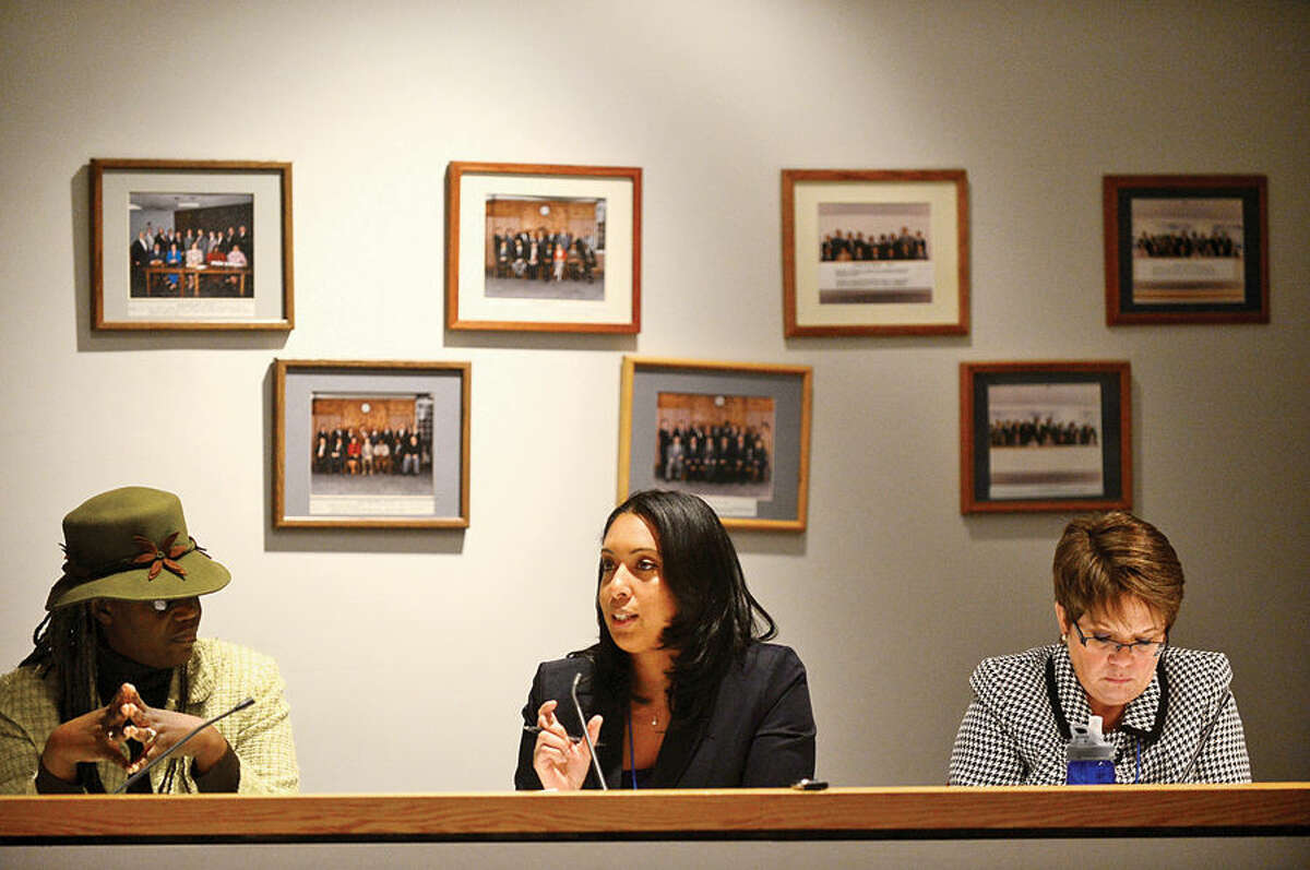Hour photo / Erik Trautmann Connecticut Department of Social Services' Crystal Redding, center, chairs a a bidders conference with Cassie Johnson and Kathy Brennan at Norwalk City Hall Tuesday to provide information to local agencies interested in becoming the new Community Action Agency for greater Norwalk area.