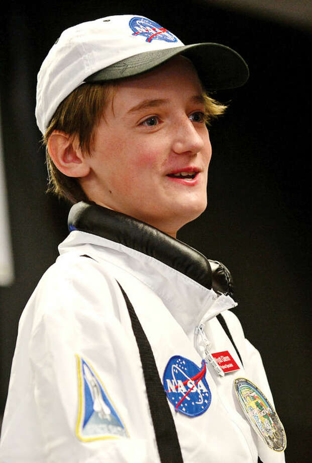 Hour photo / Erik Trautmann Payload specialist Wyatt Glenn answers question from the audience as Columbus Magnet School observes the 19th annual Young Astronaut mission, Terra Nova simulated landing at Friday morning.