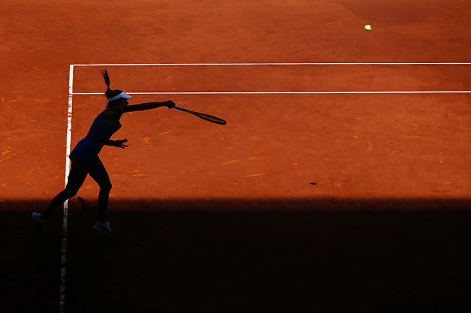 Ana Ivanovic from Serbia serves the ball during a Madrid Open tennis tournament match against Simona Halep from Romania in Madrid, Spain, Friday, May 9, 2014 . (AP Photo/Daniel Ochoa de Olza)