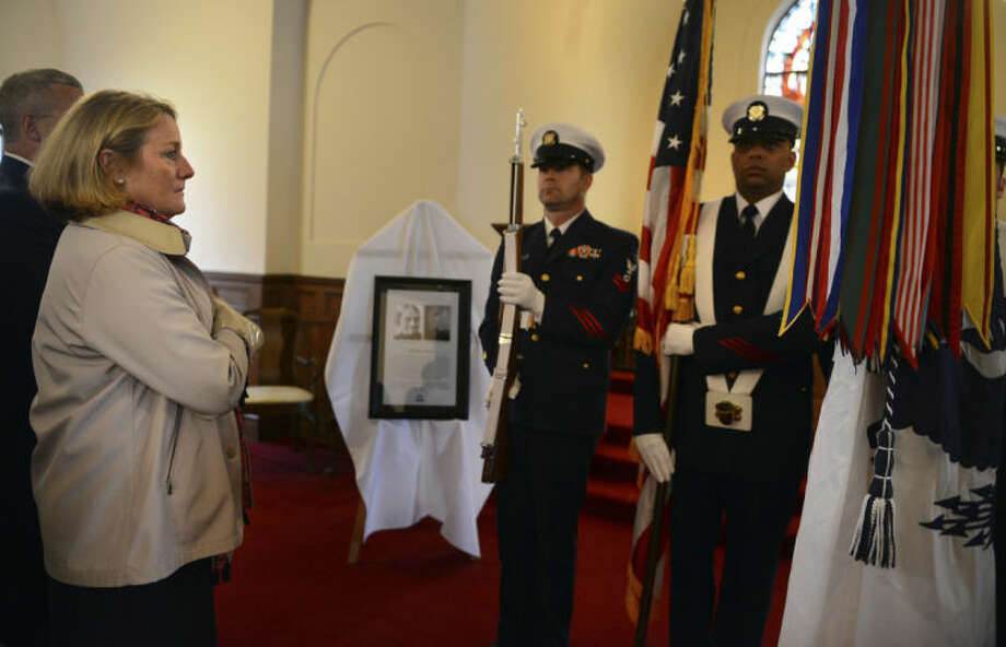 Cathy Malloy, first lady of Connecticut, stands for the presentation of the colors by the U.S. Coast Guard Color Guard Thursday, May 8, 2014, during a grave marker dedication ceremony for Kathleen Morre at Mountain Grove Cemetery in Bridgeport, Conn. Moore, a lighthouse keeper is credited with saving 21 lives during her 61 years of service. (AP Photo/The Connecticut Post, Autumn Driscoll) MANDATORY CREDIT