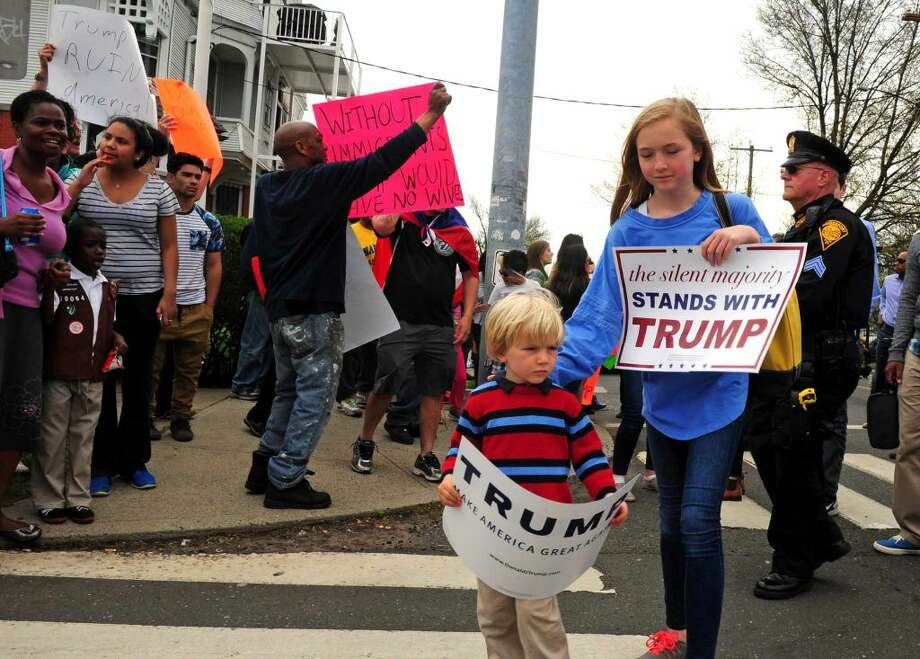 Area residents protest outside of presidential candidate Donald Trump's rally at the Klein Memorial Auditorium in Bridgeport, Conn., on Saturday Apr. 23, 2016.