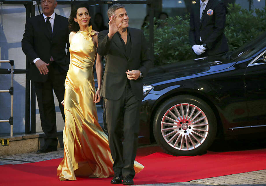 U.S. actor George Clooney and his wife, Amal, arrive for the Japan premiere of Disney's latest film Tomorrowland in Tokyo Monday, May 25, 2015. (AP Photo/Koji Sasahara)