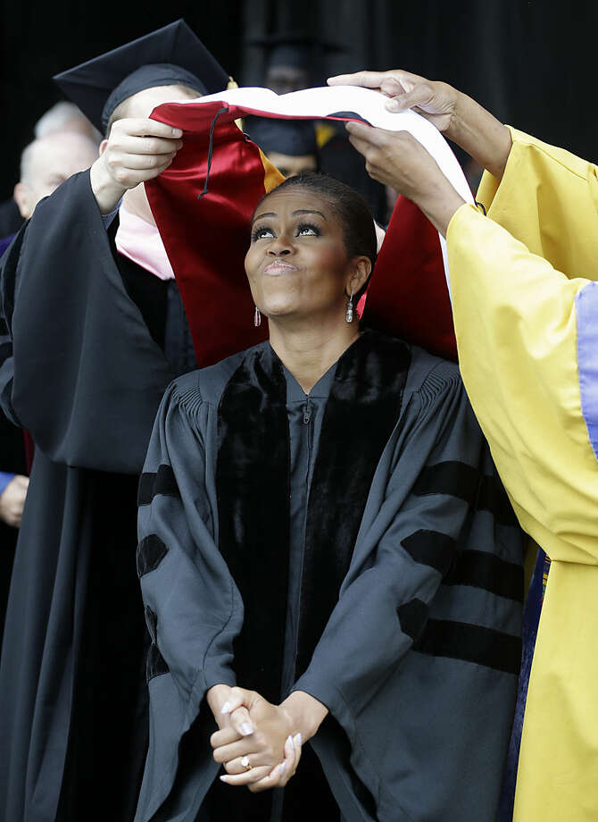 First lady Michelle Obama is hooded for an honorary degree in the Doctor of Humanities from Oberlin College, Monday, May 25, 2015, in Oberlin, Ohio. (AP Photo/Tony Dejak)