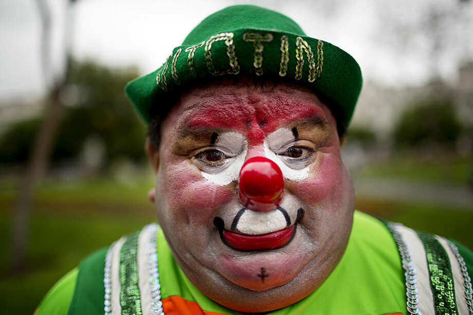 """Sorpresa"" the clown poses for a picture during a march commemorating Peruvian clown day in Lima Peru, Monday, May 25, 2015. Hundreds of professional clowns dressed in colorful costumes, wigs and face paint marched through the streets of Lima to celebrate Peruvian Clown Day. (AP Photo/Rodrigo Abd)"