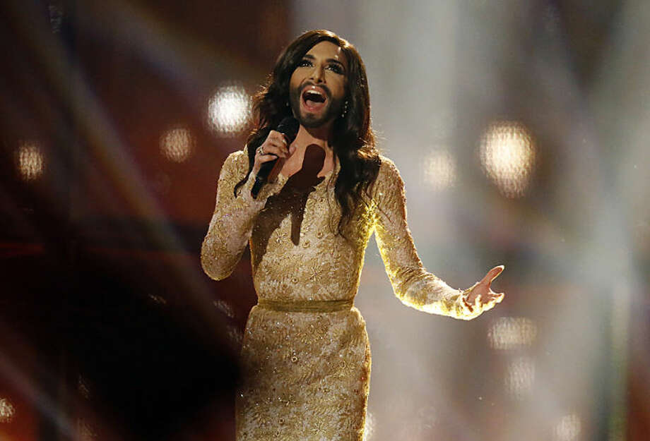 Conchita Wurst representing Austria performs the song 'Rise Like a Phoenix' during the second semifinal of the Eurovision Song Contest in the B&W Halls in Copenhagen, Denmark, Thursday, May 8, 2014.(AP Photo/Frank Augstein)