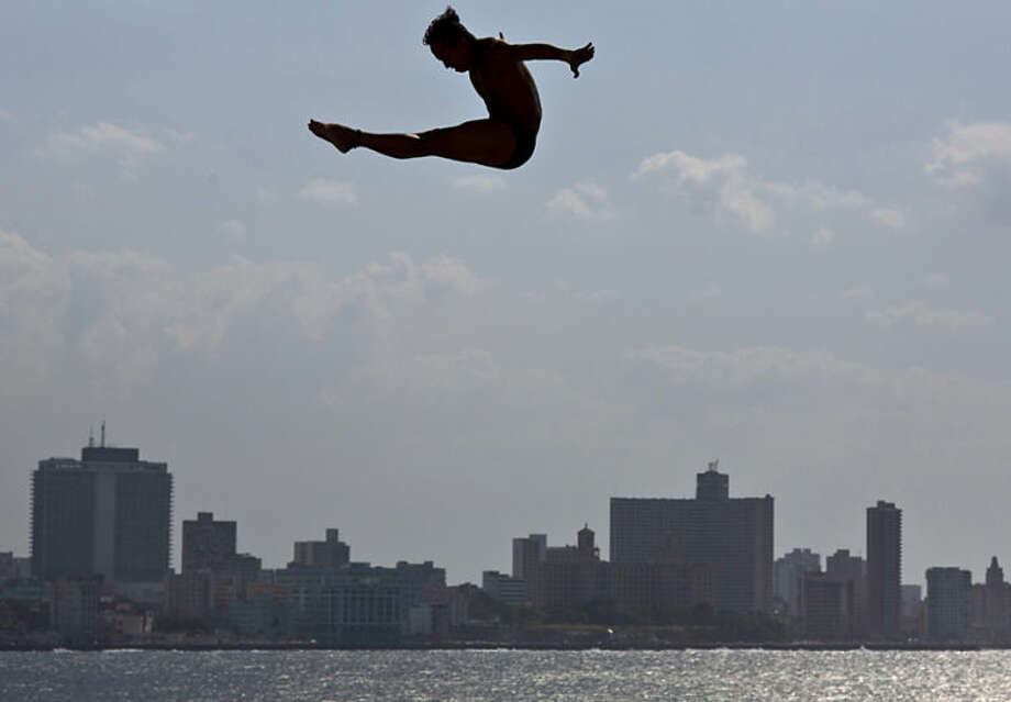 An athlete dives from Red Bull Cliff Diving World Series platform during a training session in Havana, Cuba, Thursday, May 8, 2014. The first competition of the 2014 Red Bull Cliff Diving World Series Championship will be on Saturday May 10, when the world's best cliff divers will jump from the 27-metre platform positioned on the historic Morro Castle in Havana. (AP Photo/Ramon Espinosa)