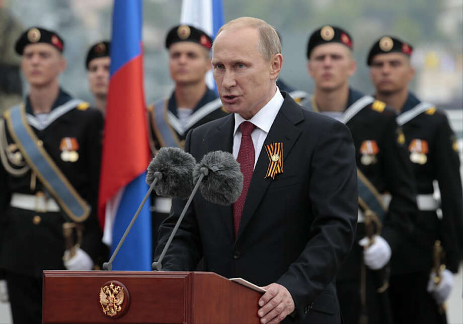 Russian President Vladimir Putin speaks at a navy parade marking the Victory Day in Sevastopol, Crimea, Friday, May 9, 2014. Crimea, which hosts a major Russian Black Sea Fleet base, is set to hold a massive navy parade in the port of Sevastopol. Putin extolled the return of Crimea to Russia before tens of thousands Friday during his first trip to Black Sea peninsula since its annexation. The triumphant visit was quickly condemned by Ukraine and NATO. (AP Photo / Ivan Sekretarev)