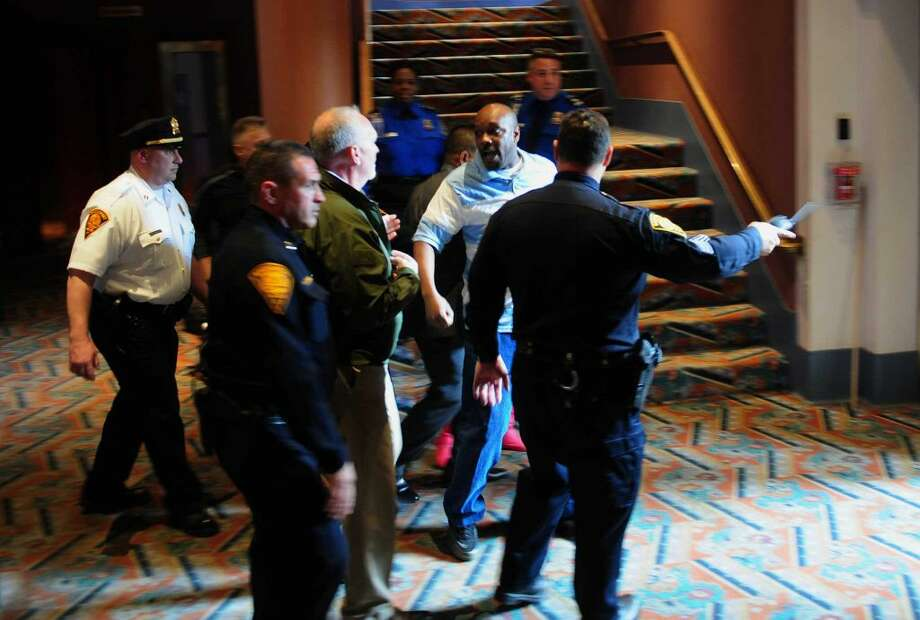 A protester is forcibly escorted out of presidential candidate Donald Trump's rally at the Klein Memorial Auditorium in Bridgeport, Conn., on Saturday Apr. 23, 2016.