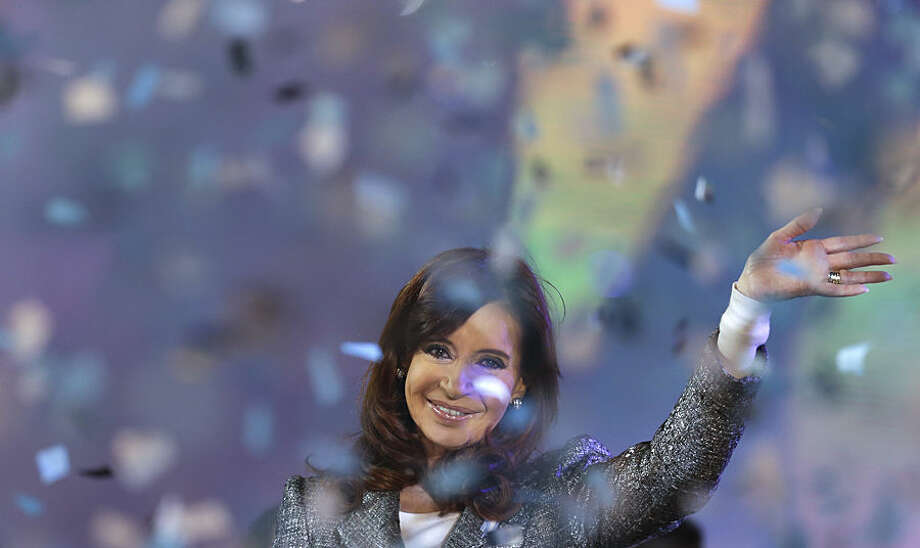 Argentina's President Cristina Fernandez smiles to supporters during the celebration of the 25 of May holiday at Plaza de Mayo in Buenos Aires, Argentina, Monday, May 25, 2015. Thousands gathered in Buenos Aires' Plaza de Mayo square to celebrate the 205th anniversary of the Argentine Revolution. (AP Photo/Natacha Pisarenko)
