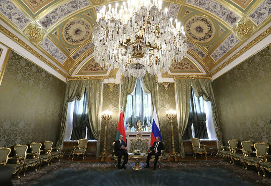 Russian President Vladimir Putin, right, and Belarusian President Alexander Lukashenko have bilateral talks after a meeting of the leaders of the member states of the Collective Security Treaty Organization (CSTO) in the Kremlin in Moscow, Russia, Thursday, May 8, 2014. (AP Photo/Sergei Karpukhin, Pool)