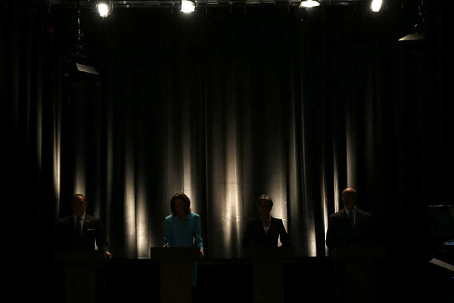 State treasurer Rob McCord, from left, former state environmental protection secretary Katie McGinty, U.S. Rep. Allyson Schwartz and businessman Tom Wolf wait for the start of the Pennsylvania Democratic Gubernatorial Primary Debate, Thursday, May 8, 2014, in Philadelphia. (AP Photo/Matt Slocum)