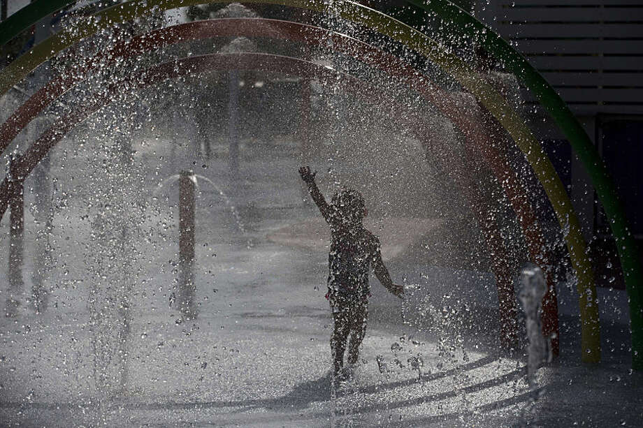 In this Wednesday, May 13, 2015 photo, a child plays in a water park in Gulf Shores, Ala. Industry officials say Gulf Coast tourism is surging, five years after the BP oil spill. (AP Photo/Brynn Anderson)
