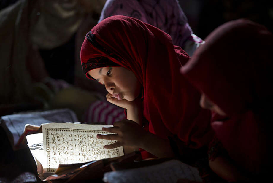 Pakistani girls study the Quran at a local madrassa, or religious school, in Islamabad, Pakistan, Thursday, May 8, 2014. (AP Photo/B.K. Bangash)