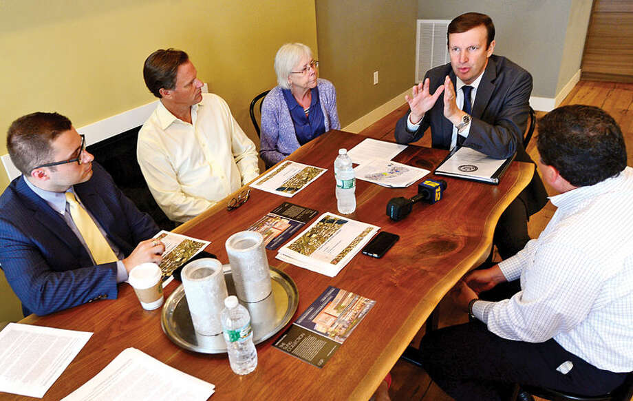 Hour photo / Erik Trautmann US Senator Chris Murphy hosted a Transit-Oriented Development Roundtable meeting with local business owners and developers of Norwalk's major mixed-use developments to learn about the City's recent transit-oriented economic development projects at Waypointe Wednesday.