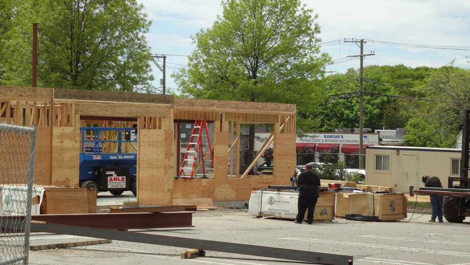 Under a new Connecticut law that takes effect in October 2016, builders must record the identities of subcontractors that pour concrete and their suppliers, with the new rules prompted by home foundation failures in Eastern Connecticut. Pictured is a new commercial building rising May 18, 2016 from its foundation on Main Avenue in Norwalk.