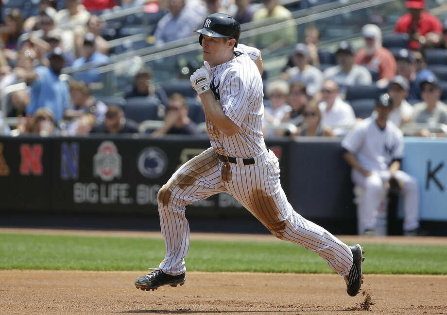 New York Yankees third baseman Chase Headley (12) heads for second base after hitting a double to left field against the Kansas City Royals during the first inning of a baseball game, Wednesday, May 27, 2015, in New York. (AP Photo/Julie Jacobson)