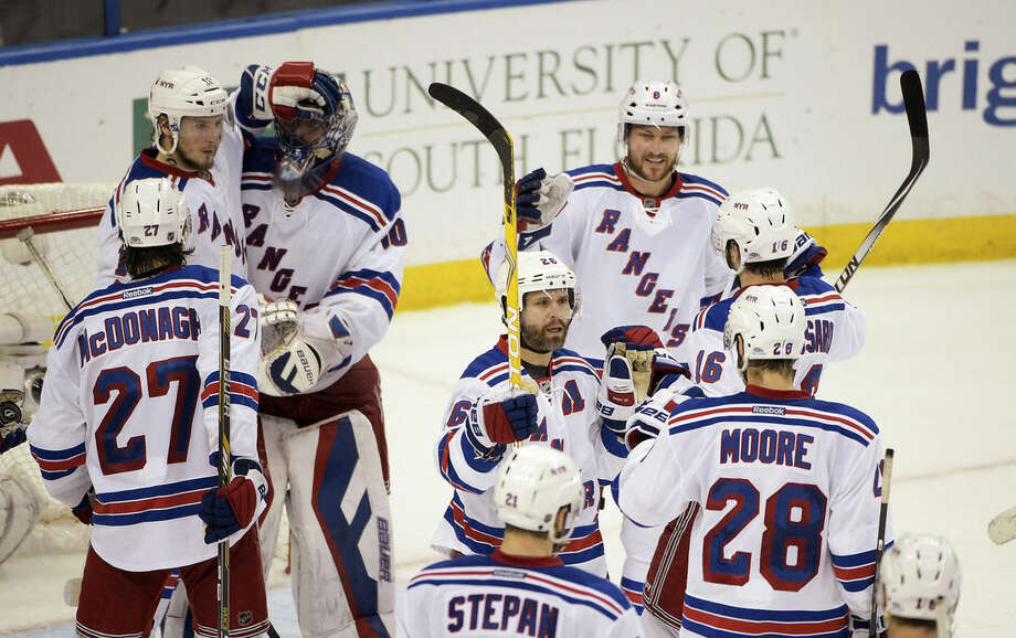 The New York Rangers celebrate their 7-3 win over the Tampa Bay Lightning in Game 6 of the Eastern Conference finals during the NHL hockey Stanley Cup playoffs, Tuesday, May 26, 2015, in Tampa, Fla. (AP Photo/Phelan M. Ebenhack)