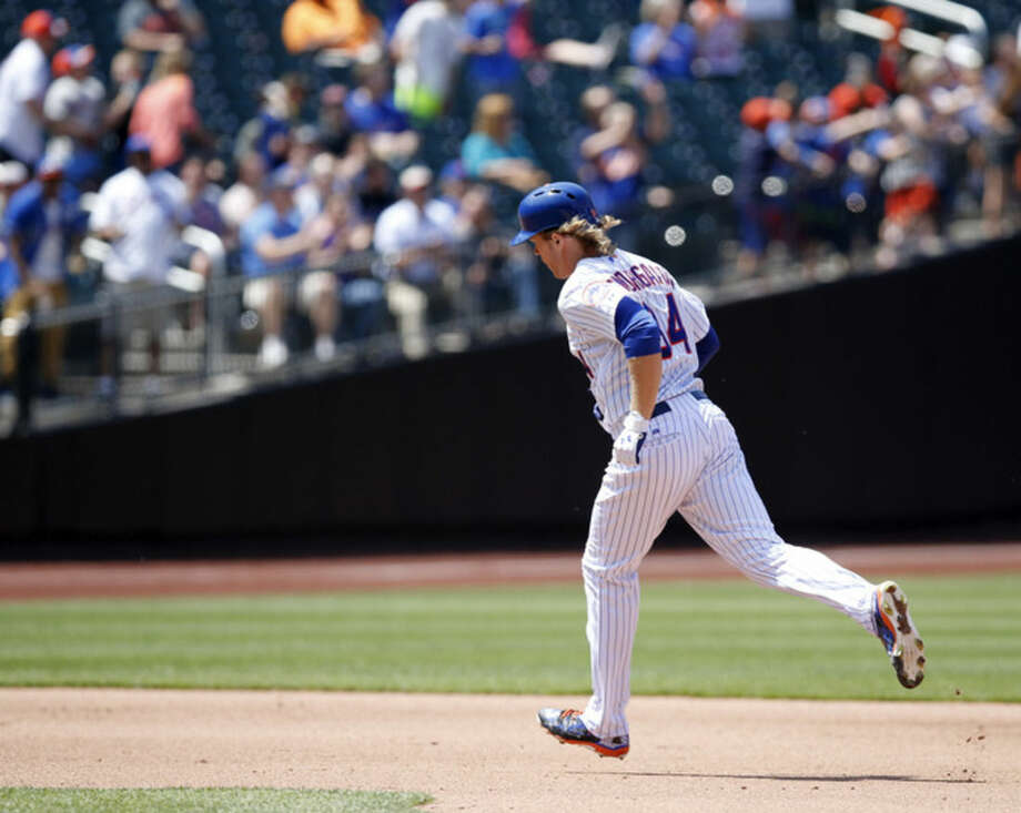 New York Mets Noah Syndergaard trots the bases after hitting a fourth-inning, solo home run off Philadelphia Phillies starting pitcher Sean O'Sullivan in a baseball game in New York, Wednesday, May 27, 2015. (AP Photo/Kathy Willens)